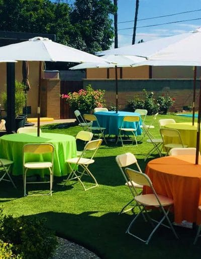 Outdoor umbrellas tables chairs and linens