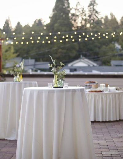 Wedding party with cocktail tables and linens