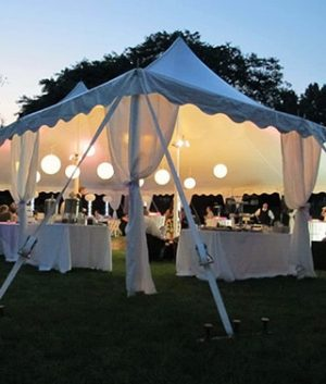 All American Party Rentals wedding tent with tables, chairs, linens and lighting