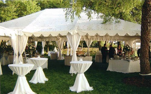 White wedding canopy with tables and chairs