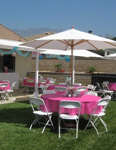 All American Party Rentals back yard event with umbrellas
