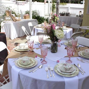 Wedding party with linens table chairs and china